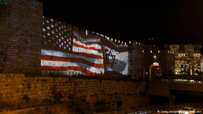 The flags of the US and Israel fly together on a wall in Jerusalem