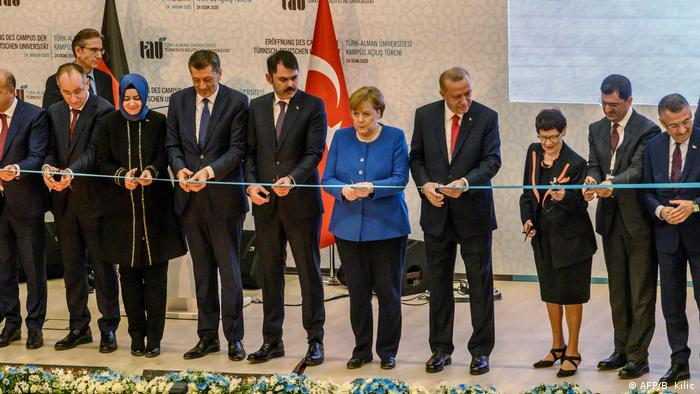 Erdogan, Merkel, and various dignitaries at the joint opening of the Turkish-German University in Istanbul (AFP/B. Kilic)