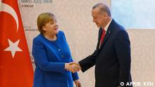 Erdogan shakes hands with Merkel in Istanbul (AFP/B. Kilic)