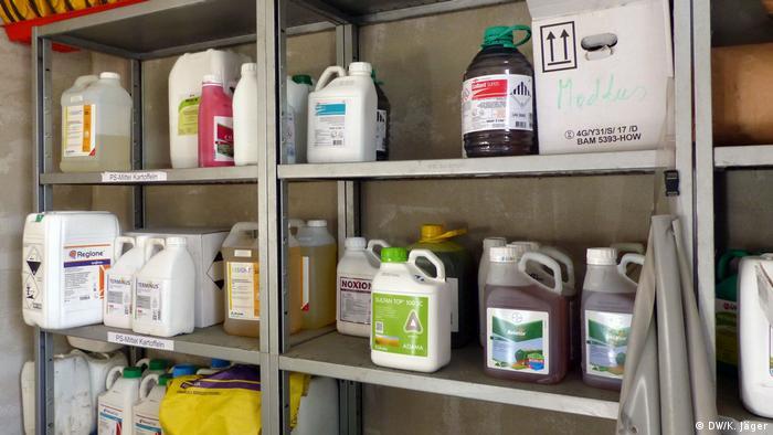 A shelf full of bottles of pesticide
