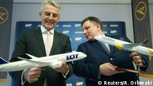 24.1.2020*** Ralf Teckentrup, chief of Condor airlines, and Rafal Milczarski, CEO of LOT Polish Airlines, pose with a model airplane after a news conference in Frankfurt, Germany, January 24, 2020. REUTERS/Ralph Orlowski