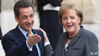 President Nicolas Sarkozy, left and Chancellor Angela Merkel