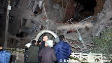 People stand outside a collapsed building after an earthquake in Elazig, Turkey, January 24, 2020. Ihlas News Agency (IHA) via REUTERS ATTENTION EDITORS - THIS PICTURE WAS PROVIDED BY A THIRD PARTY. NO RESALES. NO ARCHIVE. TURKEY OUT. NO COMMERCIAL OR EDITORIAL SALES IN TURKEY.