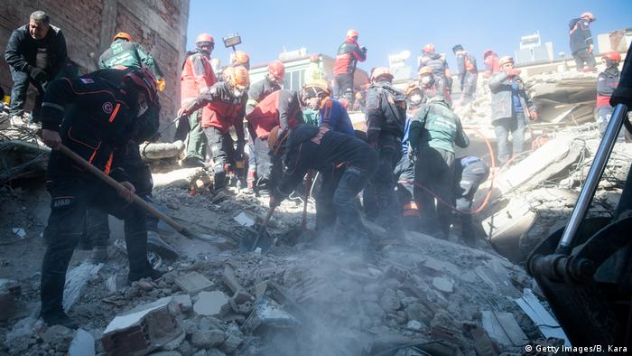 Rescue workers search among the rubble for those missing (Getty Images/B. Kara)