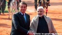 Brazil's President Jair Bolsonaro (L) shakes hands with India's Prime Minister Narendra Modi during a ceremonial reception at Rashtrapati Bhavan - The Presidential Palace in New Delhi on January 25, 2020. (Photo by Jewel SAMAD / AFP) (Photo by JEWEL SAMAD/AFP via Getty Images)