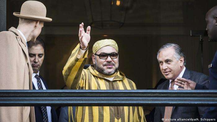 King Mohammed VI of Morocco waves at fans in Amsterdam