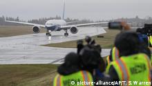 Photographers angle for images of a Boeing 777X airplane as it taxis at the start of an unsuccessful attempt to make a first flight, Friday, Jan. 24, 2020