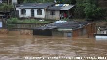 A view of flooded houses caused by heavy rains in Sabara municipality, Minas Gerais state, Brazil, Friday, Jan.24, 2020. Heavy rains caused flooding and landslides in southeast Brazil, killing at dozens of people, authorities said Saturday. (AP Photo/Flavio Tavares-Futura Press) |