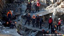 Rescue workers search the site of a collapsed building (Reuters/U. Bektas)