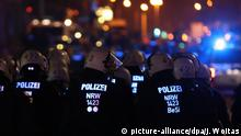 Police officers at at leftist protest in Leipzig