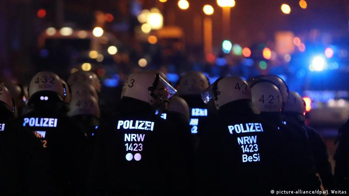 Police officers at a leftist protest in Leipzig