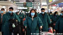Members of a medical team prepare to board a train at Zhengzhou East railway station