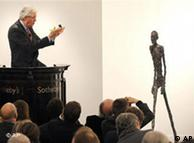 Auctioneer Henry Wyndam sells the sculpture 'Walking Man I' or 'L'Homme qui marche I', by Alberto Giacometti, at Sotheby's auction rooms in London, Feb. 3, 2010