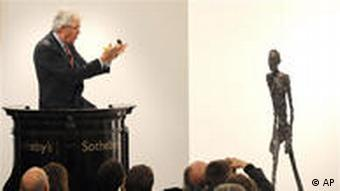 Auctioneer Henry Wyndam sells the sculpture Walking Man I (L'Homme qui marche I) by Alberto Giacometti at Sotheby's in London, on Feb. 3, 2010