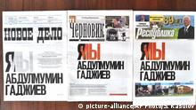 In this photo, the front pages of Dagestan's three major newspapers use the same headline that reads: I'm/we are Abdulmumin Gadzhiev, which is the name of the religious affairs editor of the independent weekly Chernovik, in a show of rare solidarity in Makhachkala, the Caspian Sea province of Dagestan, Russia, Friday, June 21, 2019. Journalists in southern Russia are protesting the arrest of a newspaper editor on terrorism charges they say were trumped up as part of an official campaign to silence independent media. (Sergei Rasulov, News Team via AP)  