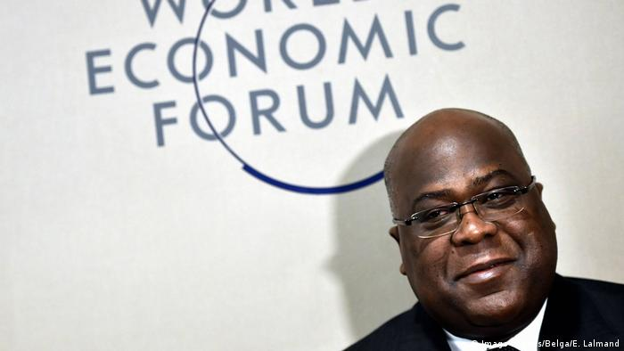 DRC Presodent Felix Tshisekedi stands before a sign of the World Economic Forum (Imago Images/Belga/E. Lalmand)