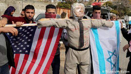 Palestinian demonstrators prepare to burn an effigy depicting U.S. President Donald Trump (Reuters/M. Salem)