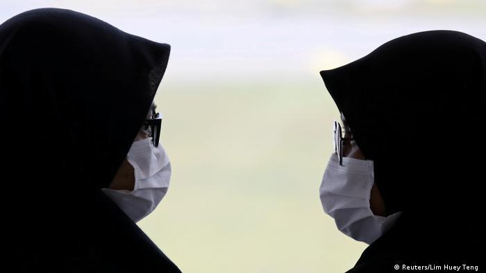 BdTD Malaysia Frauen mit Mundschutz