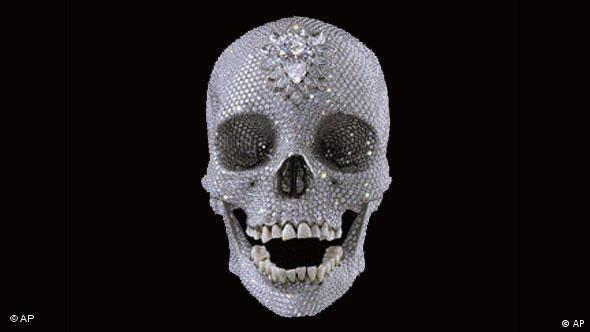 A jewel-encrusted platinum skull, seen in this image made available in Amterdam, Tuesday Aug. 26, 2008, and titled For the Love of God, created by British artist Damien Hirst, will be on display at the Rijksmuseum in Amsterdam, Netherlands for six weeks starting Nov. 1, spokeswoman Elles Kamphuis said on Tuesday, Aug. 26, 2008. The piece is decorated with 8,601 diamonds, including a large pear-shaped pink diamond in the forehead. Kamphuis says the piece was cast from a skull Hirst purchased from a London dealer of a man who died in the 18th century. The teeth are real. (AP Photo/ Prudence Cuming Associates Ltd Private Collection courtesy Murderme Ltd and Jay Jopling/White Cube, London) ** EDITORIAL USE ONLY ** NO SALES **