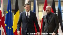 European Council President Charles Michel, right, walks with Ukraine's Prime Minister Oleksiy Honcharuk as they arrive for a meeting at the Europa building in Brussels, Tuesday, Jan. 28, 2020. (AP Photo/Virginia Mayo)  