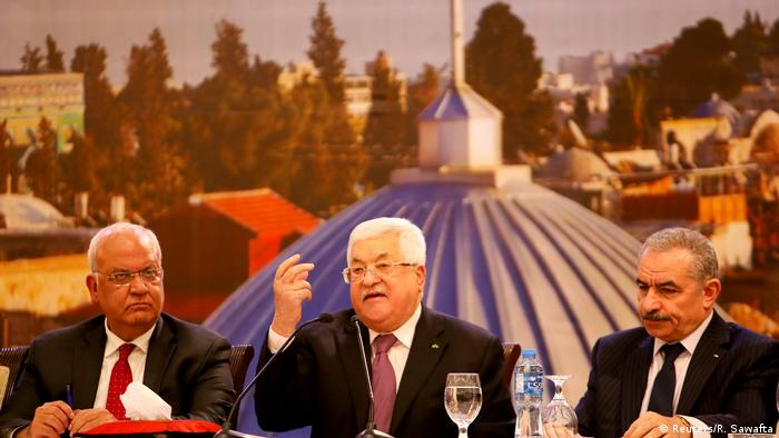Palestinian Authority President Mahmoud Abbas (middle) reacts to the White House 'peace plan' for the Middle East