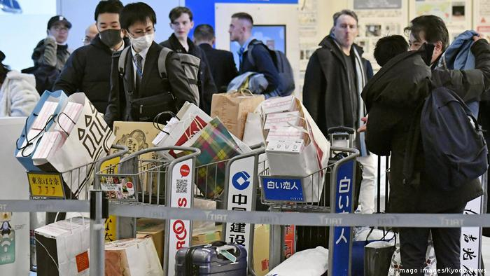 Japanese officials prepare to load medical supplies onto a plane in Tokyo