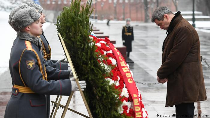 Bavarian State Premier Markus Soeder takes part in a wreath laying ceremony at the Tomb of Unknown Soldier outside Kremlin wall, in Moscow