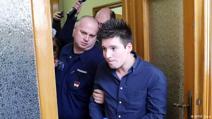Rui Pinto, the whistleblower behind Football Leaks, is escorted into court