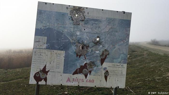 A sign with bullet holes in the Evros delta