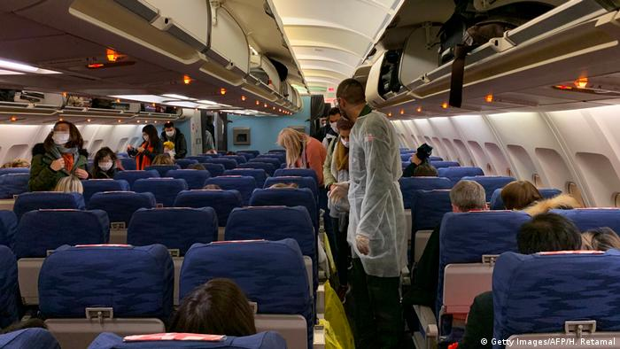 French citizens settle aboard the evacuation plane