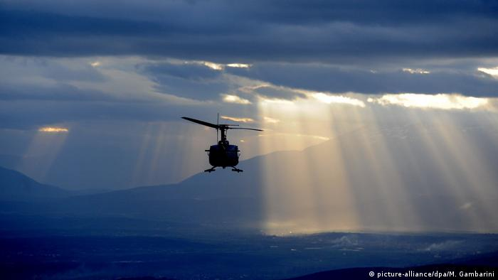 A helicopter flies over Kosovo