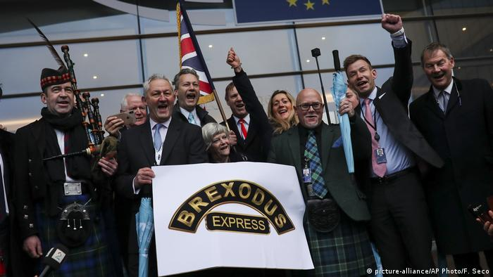 ritish MEP's celebrate as they march out of European Parliament with their luggage in Brussels to take the Eurostar train back to Britain