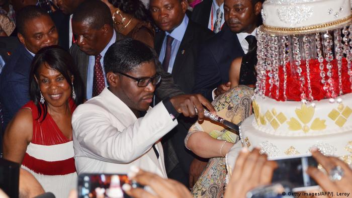 Teodorin Obiang cuts birthday cake with his mother and guests in the background (Getty Images/AFP/J. Leroy)