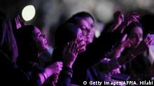 Saudi women attend a concert by Egyptian pop sensation Tamer Hosny in the western city of Jeddah on March 30, 2018. - Thousands of fans were taken by surprise when tickets for Hosny's first-ever Saudi concert came with the edict that dancing was strictly prohibited. (Photo by Amer HILABI / AFP) (Photo credit should read AMER HILABI/AFP via Getty Images)