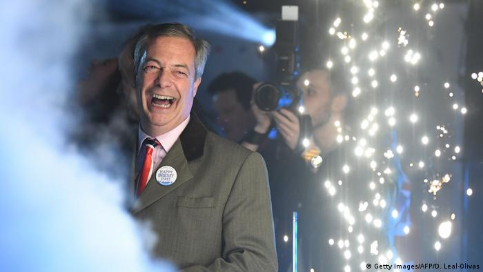 Nigel Farage smiles on stage in Parliament Square in central London on January 31, 2020