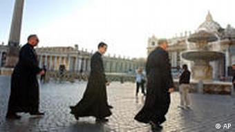 Three Catholic priests walk across St. Peter's Square in Rome