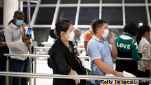 ADDIS ABABA, ETHIOPIA - JANUARY 31: A passenger wears a mask following an outbreak of the Coronavirus in China at Addis Ababa Bole International Airport on January 31, 2020 in Addis Ababa, Ethiopia. The number of those who have died from the Wuhan coronavirus, known as 2019-nCoV, in China climbed to over 213 on Friday and cases have been reported in other countries including the United States, Canada, Australia, Japan, South Korea, India, the United Kingdom, Germany, France and several others. (Photo by Luke Dray/Getty Images)