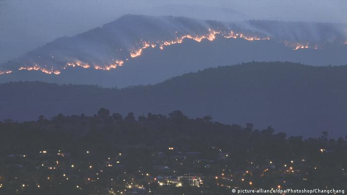 A line of fire moving over a hilltop