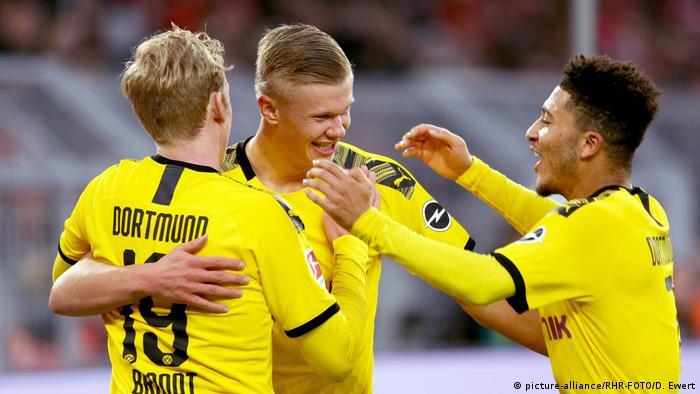 Julian Brandt, Erling Haaland und Jadon Sancho celebrate a goal