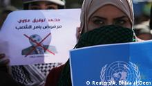 02.02.2020 *** University students carry a U.N. flag and a sign depicting the newly appointed Prime Minister of Iraq, Mohammed Tawfiq Allawi, during ongoing anti-government protests in Kerbala, Iraq February 2, 2020. REUTERS/Abdullah Dhiaa al-Deen