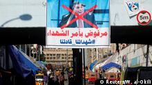 02.02.2020 *** A poster depicting the newly appointed Prime Minister of Iraq, Mohammed Tawfiq Allawi, is seen at the Tahrir Square, during ongoing anti-government protests in Baghdad, Iraq February 2, 2020. REUTERS/Wissm al-Okili