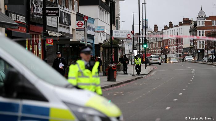 Police are seen near a site where a man was shot by armed officers in Streatham, south London