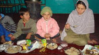 Afghan woman with children