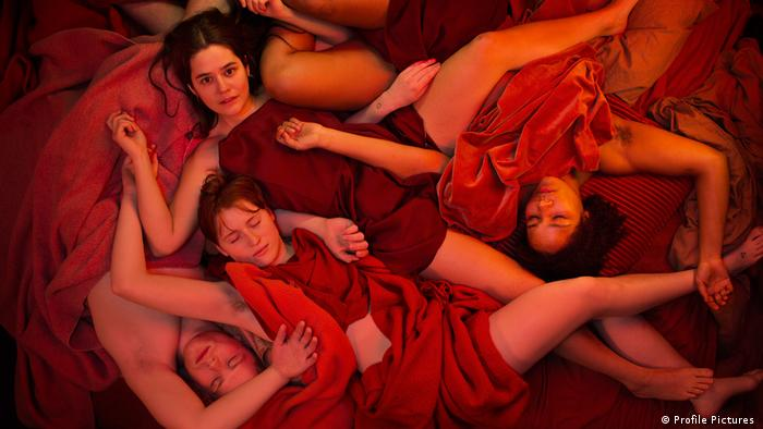 Film still Sex , women lying down, covered by red bits of cloth (Profile Pictures )