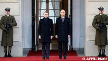 French President Emmanuel Macron (L) and Polish President Andrzej Duda take part in a welcoming ceremony at the presidential palace, on February 3, 2020 in Warsaw. (Photo by Ludovic Marin / AFP)