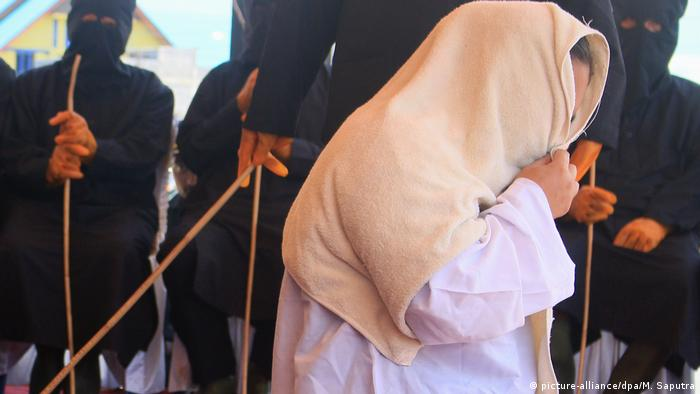 A woman is caned in Aceh