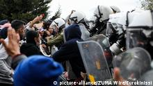03.02.2020 February 3, 2020, Lesvos Island, Greece: Riot police use tear gas against protesting refugees and migrants during a demonstration on the northeastern Aegean island of Lesbos. The clashes broke out after police prevented protesters from reaching the island's main town of Mytilene. The demonstration was held to protest severe overcrowding at the island's refugee camp and delays in the asylum procedure. (Credit Image: © Eurokinissi via ZUMA Wire  
