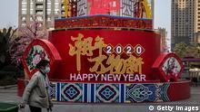 China Wuhan   Coronavirus   Frau mit Schutzmaske