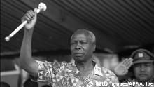 NYAHURURU, KENYA: Kenya's President Daniel Arap Moi, who is also the leader of the ruling Kenyan African National Union (KANU) party shown in a picture dated 28 December 1992 brandishing a stick as he addresses members of his party. (Photo credit should read ALEXANDER JOE/AFP via Getty Images)