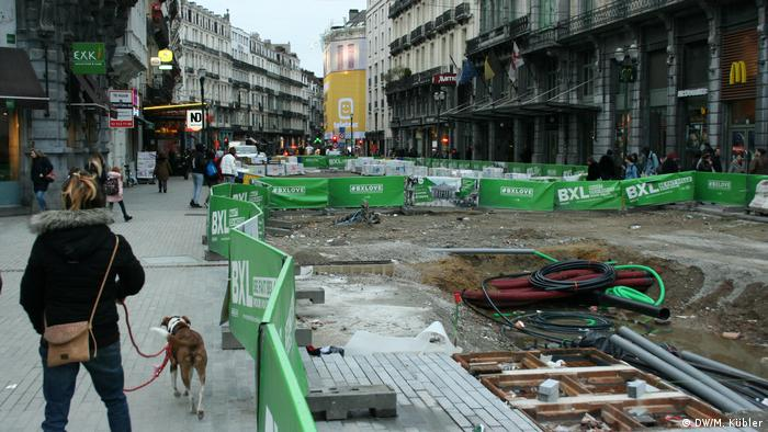 Pedestrians navigate the roadworks at Place de la Bourse, Brussels